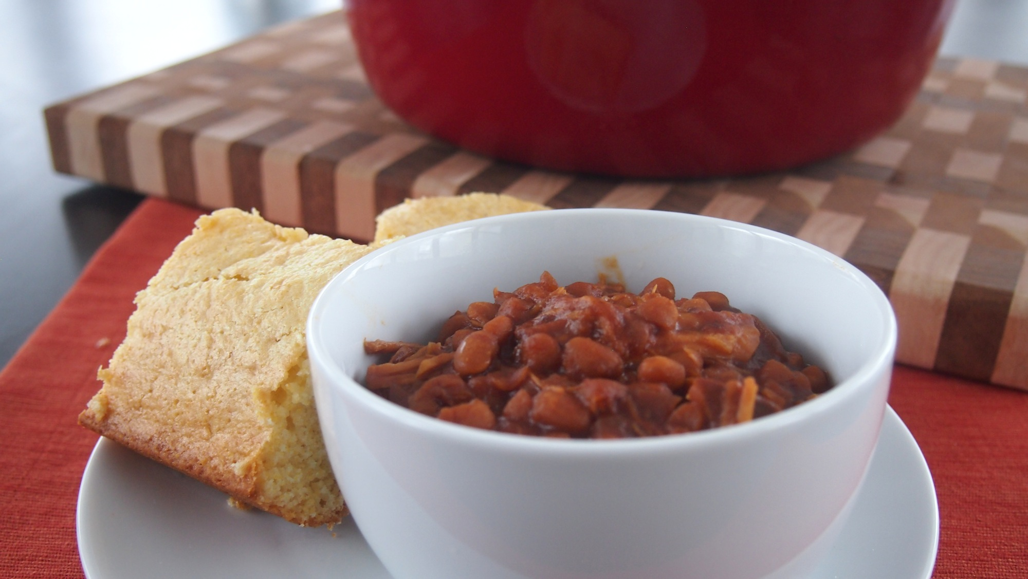 A bowl of beans with cornbread.